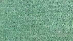 Artificial green grass. Top view of the texture. Fine artificial green grass on the lawn. Top view of the texture royalty free stock photography