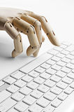 Artificial hand using a computer keyboard Royalty Free Stock Photo