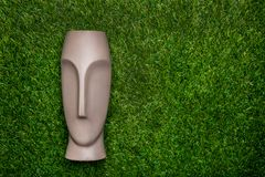Artificial head lying on green grass Stock Image