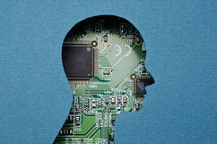 Artificial intelligence. Cardboard human head cutout revealing circuit board content Royalty Free Stock Photos