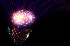 Artificial intelligence concept. Hand holding smartphone with glowing polygonal brain on dark background. Artificial intelligence concept. 3D Rendering stock image