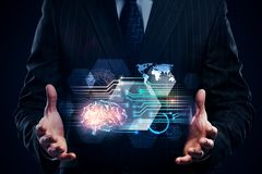 Artificial intelligence and future concept. Businessman holding abstract digital brain interface on black background. Artificial intelligence and future concept royalty free stock photos