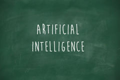 Artificial intelligence handwritten on blackboard Royalty Free Stock Photo