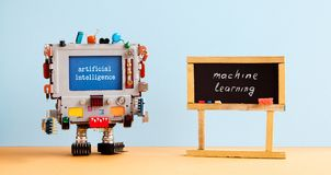 Artificial intelligence machine learning. Robot computer black chalkboard classroom interior, future technology concept.  royalty free stock images