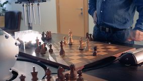 Artificial intelligence, robot chessplayer playing chess with a man. 4K.