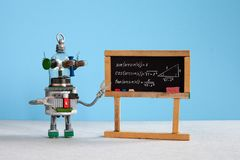 Artificial intelligence and trigonometry lesson in college. Robot teacher explains theory inverse trigonometric. Functions. Classroom interior with handwritten royalty free stock image