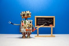 Artificial intelligence and trigonometry lesson in college. Robot teacher explains theory inverse trigonometric. Functions. Classroom interior with handwritten royalty free stock photos