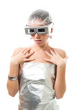 Artificial intelligence woman. In silver metallic clothes and glasses, fashion like, isolated on white