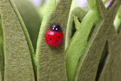 Artificial ladybird on artificial grass Stock Images