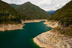 An artificial lake. An artificial lake in mountains with low water level Stock Images