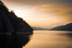 Artificial Lake behind the Bicaz Dam at sunset Royalty Free Stock Image