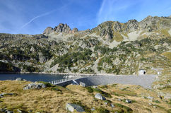 Artificial lake with a dam in the Haut-Pyrenees Stock Image