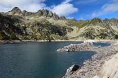 Artificial lake with a dam in the Haute-Pyrenees Royalty Free Stock Photography