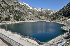 Artificial lake with a dam in the mountains Royalty Free Stock Photos