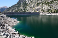 Artificial lake with a dam in the mountains Stock Photo