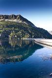 Artificial lake of the dam at the sunset Royalty Free Stock Images