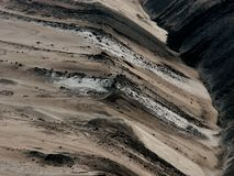 Artificial landscape in an open pit. Artificial landscape build of mine spoil in an open pit Stock Image