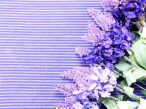 Artificial lavender flowers bouquet on fabric background Stock Photos