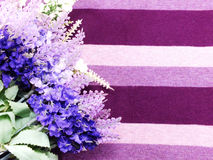 Artificial lavender flowers bouquet on fabric background Stock Photography