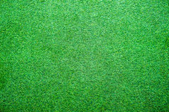 Artificial lawn grass green bright background Royalty Free Stock Photo