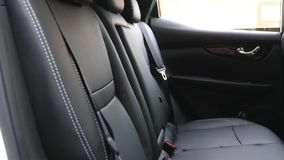 Artificial leather rear seats in the car. beautiful leather car interior design. luxury leather seats in the car. Black. Artificial leather rear seats in car stock video footage