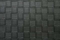 Artificial leather small square texture gunpowder grey color Royalty Free Stock Photography