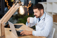 Selective focus of a light bulb. Artificial light. Selective focus of a light bulb shining late at nice in the doctors office Stock Photography