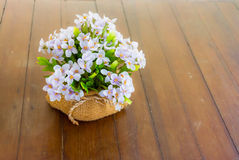 Artificial Lilac Flowers in the sack pot Royalty Free Stock Image