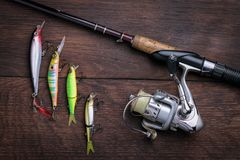 Artificial lures for fishing and spinning top view stock images