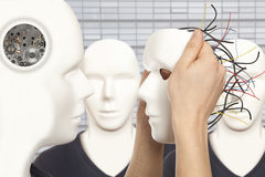 Artificial man concept - android robot holds clone white face m. Cyborg, clone, robot and artificial man concept - android robot holds clone white face mask stock images