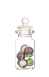 Artificial mangosteen in the bottle isolated on white Royalty Free Stock Photo