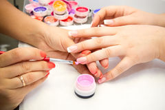 Artificial nails in a beauty salon Royalty Free Stock Photos