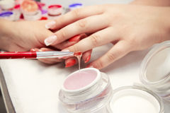 Artificial nails in a beauty salon Royalty Free Stock Photo