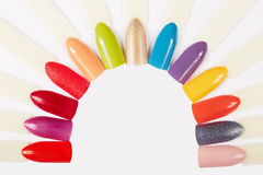 Artificial nails different colored with nail polish Royalty Free Stock Photo