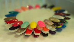 Artificial nails in different colors Royalty Free Stock Image