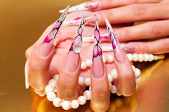 Artificial nails and pearls Royalty Free Stock Photo