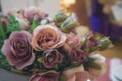 Artificial pink rose bouquet - vintage tone. Artificial pink rose bouquet - soft focus and vintage tone Stock Image