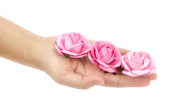 Artificial pink rose in hand Stock Photo