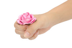 Artificial pink rose in hand Stock Photos