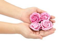Artificial pink rose in hand Royalty Free Stock Image