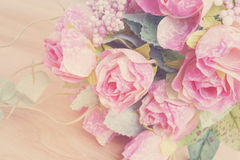 Artificial pink roses bouquet on wood Stock Photography