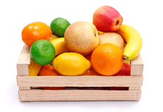 Artificial plastic fruits in wooden crate Royalty Free Stock Photos