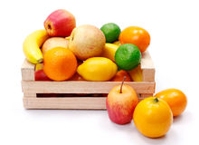 Artificial plastic fruits in wooden crate Royalty Free Stock Image