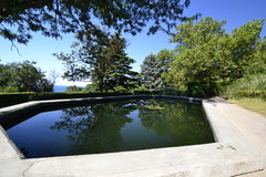 Artificial pond Stock Images