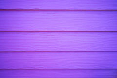 Artificial purple wood texture Stock Images