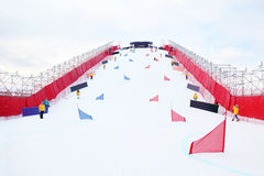 Artificial ramp for parallel slalom snowboardind. At championship at winter day royalty free stock photo