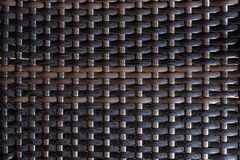 Artificial Rattan Background. Closeup View of Dark Artificial Rattan Stock Photos