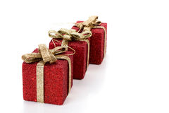 Artificial red gift boxes. Decorated Stock Photos