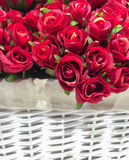 Artificial Red Roses in The White Basket Background Texture, Vintage Theme Royalty Free Stock Photography