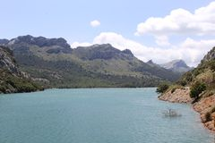 Artificial reservoir and lake Cuber, Mallorca, Spain. Artificial lake Cuber for the production of energy and electricity in the Tramuntana Mountains in Mallorca Royalty Free Stock Photo